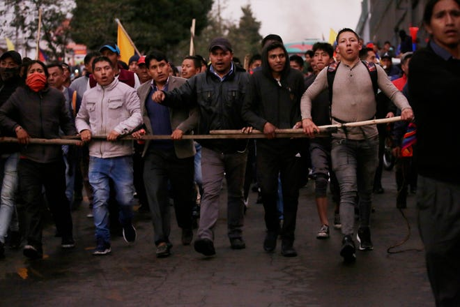 Indigenous people who traveled from their communities arrive by foot to join anti-government protests in Quito, Ecuador, on Oct. 7, 2019.