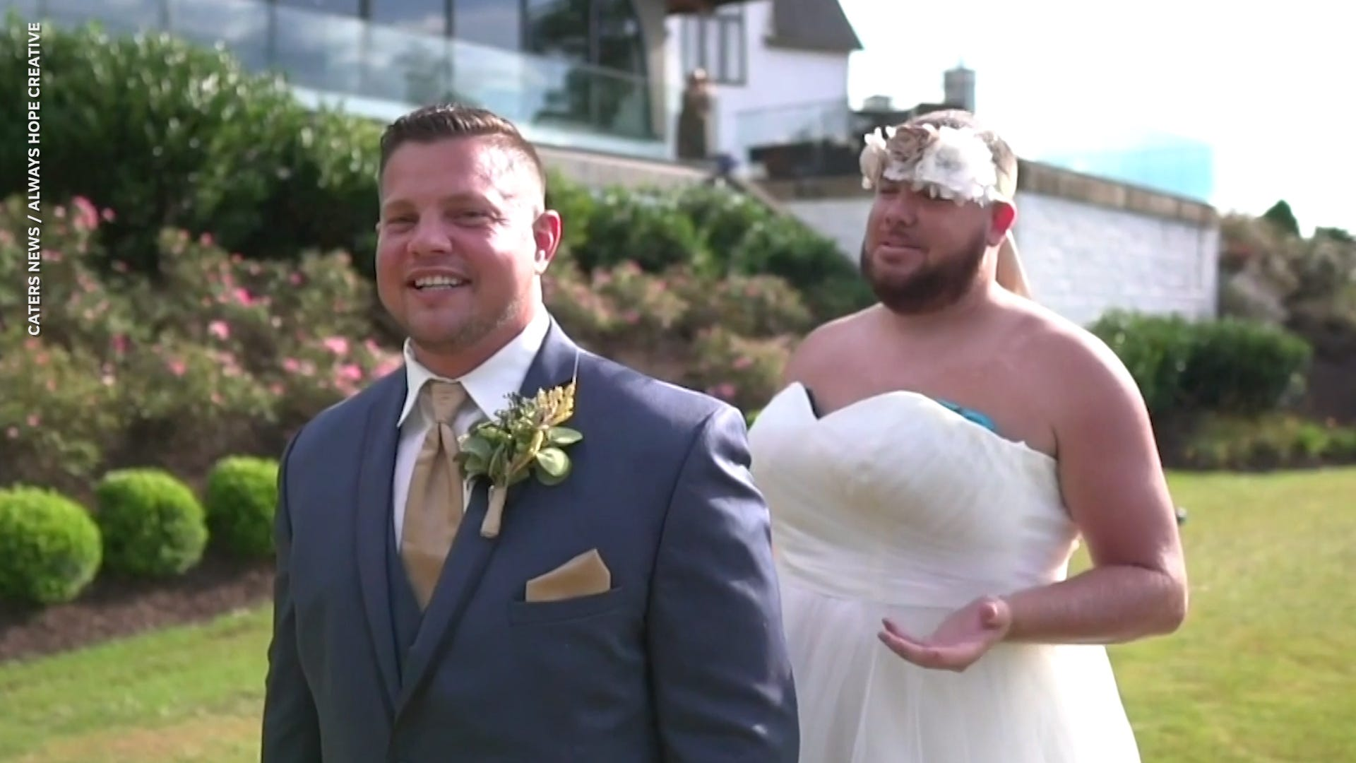 Best man pranks groom by wearing wedding dress for first look