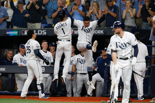Rays shortstop Willy Adames celebrates his home run with right fielder Avisail Garcia.