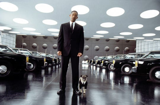 "Agent J (Will Smith) and Frank the Pug team up in ""Men in Black II."""