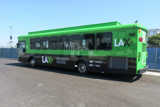 The green LAX-it shuttle picks up passengers from all of the terminals and brings them to a new designated pickup area for hailing cabs, Ubers and Lyft rides.