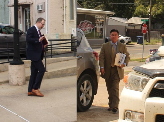 Drew Mason (left), a Vernon Parish assistant district attorney, and Elvin Fontenot (right) enter the Vernon Parish Courthouse on Wednesday.