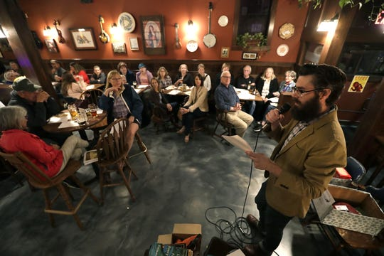 Richie Zaborowske hosts a Short Story Night gathering Wednesday at McFleshman's Brewing Co. in Appleton. The event was part of the Fox Cities Book Festival.