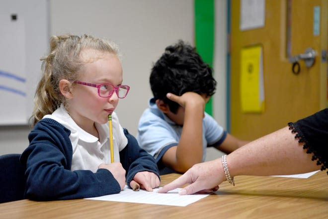 Carolina Day School's Key School second-grader Ellie looks up at her teacher, Mary Holmes, as she thinks through a letter sound at the school on Oct. 8, 2019. Students at the school have dyslexia and other language-based learning obstacles are taught using a multi-sensory process.