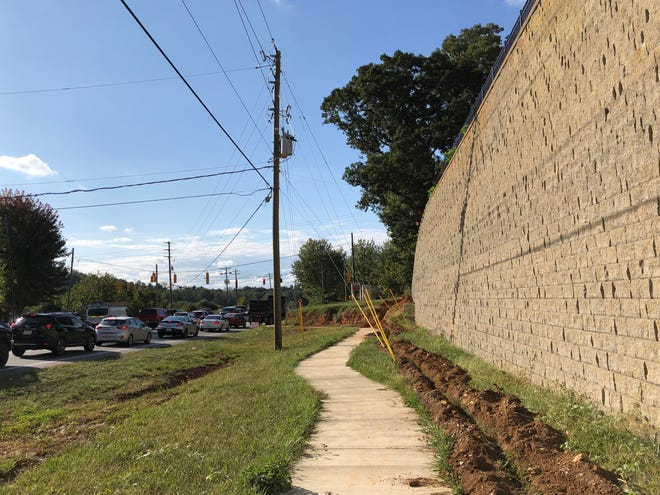 """Trees will go in over the next few weeks along the """"castle wall"""" at the new Hawthorne at Mills Gap apartment complex in Arden."""