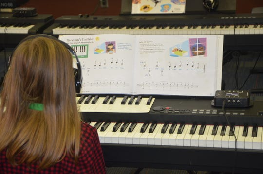 Bella Furman practices a new song on the keyboard during her time with the Gilmore's Piano Lab program at Ann J. Kellogg Elementary School.