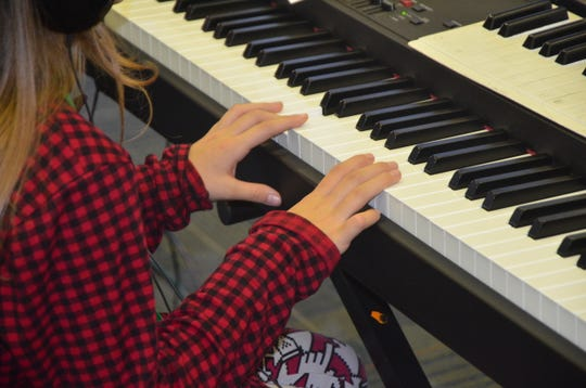 Bella Furman's fingers lay across the keyboard as she prepares to practice a new song as part of the Gilmore's Piano Lab program at Ann J. Kellogg Elementary School.