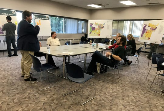 Residents discuss zoning with Paul Lippens, the project manager for the Battle Creek zoning ordinance and map amendment project at McKenna.