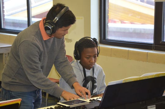Ronnie Cung teaches Raymon Payne a new song during their time in the Gilmore's Piano Lab program at Ann J. Kellogg Elementary School.