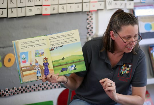 """Heather Beal reads students her book """"Tummy, Rumble, Quake"""" at Sycamore Tree Preschool in Bremerton on Wednesday."""