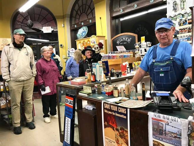 """Swannanoa Valley historian, Bill Alexander, right, tells tour participants about the history of Town Hardware's building on the museum's 2018 Historic Haunted House Tour, including the time Elvis visited the dentist office that once occupied the building's second floor."""""""