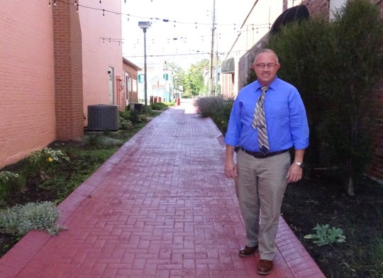John Rostash, Crestline village administrator, stands in a pedestrian walkway in downtown Crestline.