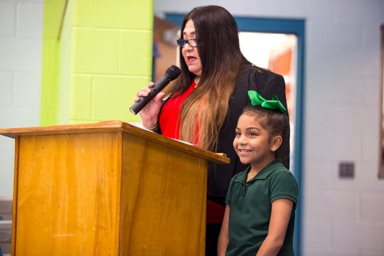 Patsy Vazquez-Contes, left, reads Kaylee Gomez's essay, for which she was awarded a Chromebook. She was one of eight students recognized at Shaw Elementary School as part of the American GI Forum Beatrice T. Perez Robstown Women's Chapter annual essay contest. Students at three schools were surprised with the tablets on Thursday, October 10, 2019. The theme of the essay this year was how the American GI Forum promotes higher education to live out the American Dream.