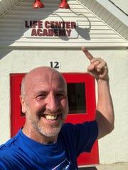 Life Center Academy headmaster Russ Hodgins is running in the Chicago Marathon on Oct. 13 to raise money for scholarships to help underprivileged kids attend LCA.