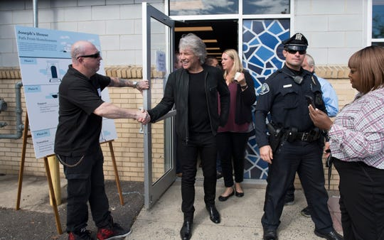 Jon Bon Jovi exits Joseph's House in Camden after attending an event to celebrate its expansion from a nighttime shelter to a full-service, all day facility with on-site outreach services.  The Jon Bon Jovi Soul Foundation partnered with several organizations to help provide funding to help open Joseph's House in its current location.