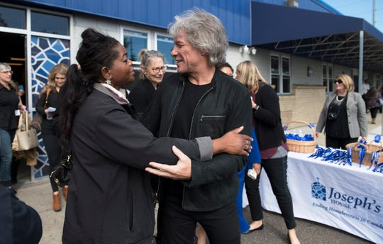 Jon Bon Jovi embraces Pauline Bruce, who is currently staying at Joseph's House in Camden, as they attend an event held at Joseph's House to celebrate its expansion from a nighttime shelter to a full-service, all day facility with on-site outreach services.  The Jon Bon Jovi Soul Foundation partnered with several organizations to help provide funding to help open Joseph's House in its current location.
