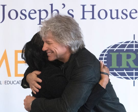 Jon Bon Jovi hugs Joseph's House volunteer Liz Holmes, who was once homeless and is now a year and four months sober, during an event to held at Joseph's House in Camden to celebrate its expansion from a nighttime shelter to a full-service, all day facility with on-site outreach services.  The Jon Bon Jovi Soul Foundation partnered with several organizations to help provide funding to help open Joseph's House in its current location.