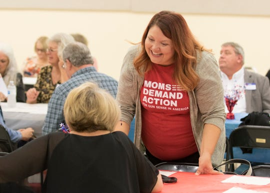 Breanne Spetnagel wears a shirt demanding gun control action at the 2019 Ross County Democratic Party fundraising dinner in Chillicothe, Ohio.