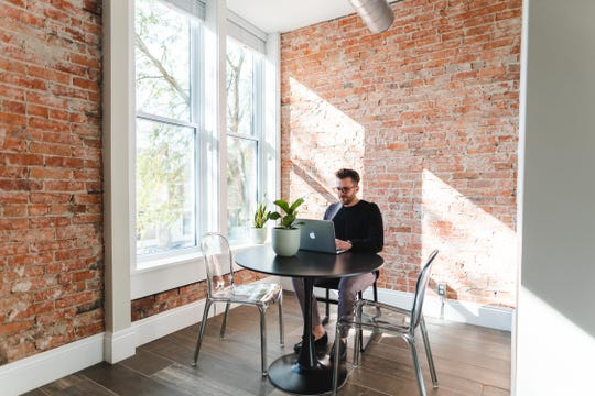 Bryce Eldridge rents a two-bedroom apartment above Paper City Coffee which he uses as an office space. The apartment has large windows facing South Paint Street and historical touches throughout.