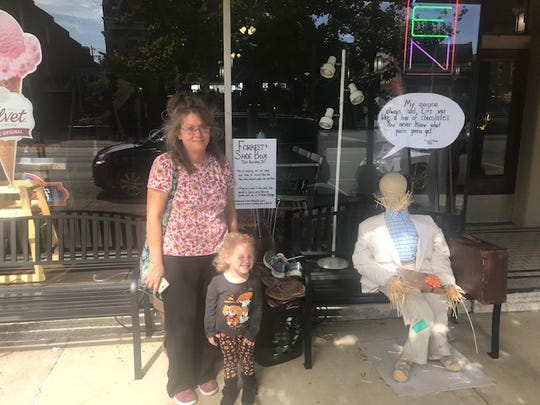 Lora Raines donates shoes outside the antique emporium on Oct. 10. Raines created a Woody from Toy Story scarecrow for the contest, which can be found outside the Ross County Courthouse.