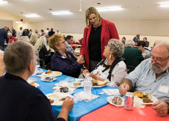Dayton mayor Nan Whaley shakes Ronda Kinnamon's hand as she talks to others in attendance before her speech at the 2019 Ross County Democratic Dinner Party on Oct. 9, 2019.