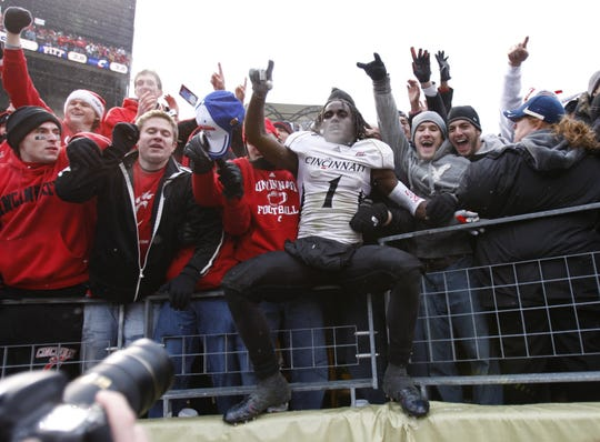 University of Cincinnati's Mardy Gilyard celebrates with fans following their defeat over the  University of Pittsburgh during  in their game played at Heinz Field in Pittsburgh, Pennsylvania Saturday December 5, 2009.