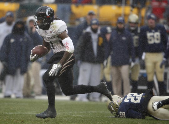 University of Cincinnati's Mardy Gilyard returns a kick-off 99 yards for a touchdown against the University of Pittsburgh during the second quarter of their game played at Heinz Field in Pittsburgh, Pennsylvania Saturday December 5, 2009. On the ground is Pitt's Antwuan Reed.