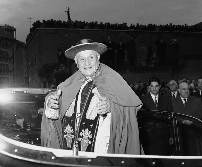 In this file photo taken in March, 1962, Pope John XXIII is shown outside the Church of Canadian Martyrs in Rome, following the Sunday Lenten services. Popes John Paul II and John XXIII will be declared saints on April 27, 2014. Pope Francis announced the date Monday, Sept 30, 2013,  during a meeting with cardinals inside the Apostolic Palace.
