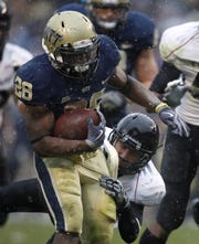 University of Pittsburgh'sDion Lewis, 28, breaks a tackle by University of Cincinnati's Brad Jones to score a touchdown during the fourth quarter of their game played at Heinz Field in Pittsburgh, Pennsylvania Saturday December 5, 2009. UC won 45-44.