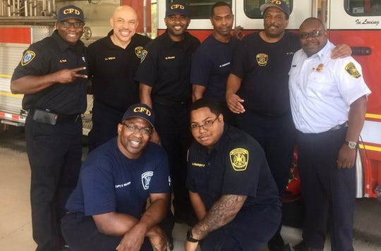 Fire Captain Ronald Wilson, bottom left, died suddenly in his home Thursday. He was a 25-year veteran of the Cincinnati Fire Department.
