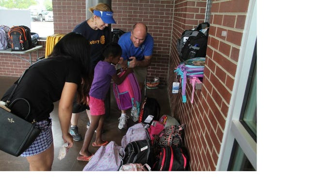 Children in the Big Brothers Big Sisters of Clarksville program receive backpacks full of school supplies courtesy of the Clarksville Sunset Rotary.