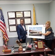 Linden Mayor Derek Armstead and Council President Michele Yamakaitis display a rendering of the Chick-fil-A restaurant coming to Linden.