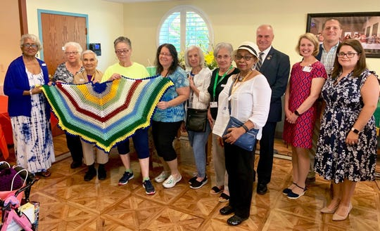 On Monday, Sept. 23, members of the Silver Linings at Old Bridge senior center presented more than 50 handmade shawls to residents of the Reformed Church Home.