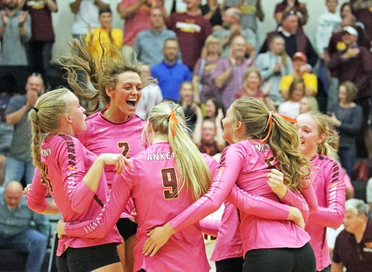 The Hawkettes celebrate the final winning point as the No. 4 Ankeny Hawkettes compete against their crosstown rival No. 9 and defending State Champion Ankeny Centennial Jaguars in a volleyball match on Tuesday, Oct. 8, 2019, at Ankeny Centennial High School. Ankeny High won 3-0.