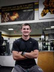 Clear Lake senior Nick Danielson poses for a photo in the weight room on Wednesday, Oct. 9, 2019 in Clear Lake. The Lions football player lost his father in February after a lengthy battle with cancer.
