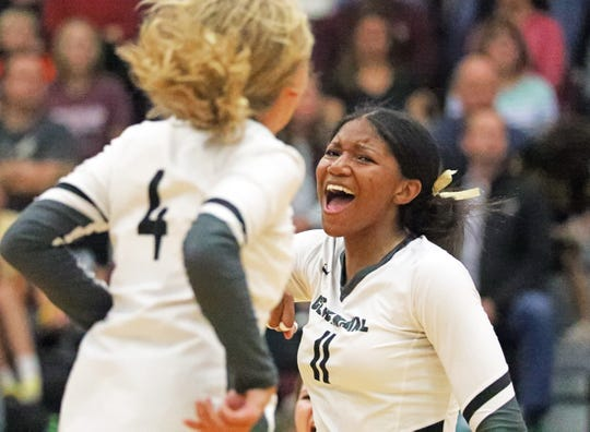 Ankeny Centennial senior and Wisconsin signee Devyn Robinson celebrates in a volleyball match on Tuesday, Oct. 8, 2019, at Ankeny Centennial High School.