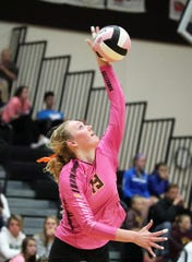 Ankeny Hawkette junior Phyona Schrader serves as the No. 4 Ankeny Hawkettes compete against their crosstown rival No. 9 and defending State Champion Ankeny Centennial Jaguars in a volleyball match on Tuesday, v at Ankeny Centennial High School. Ankeny High won 3-0.