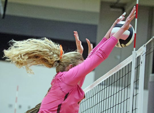 Ankeny junior Phyona Schrader blocks the opposing shot against Ankeny Centennial Jaguars in a volleyball match on Oct. 8.