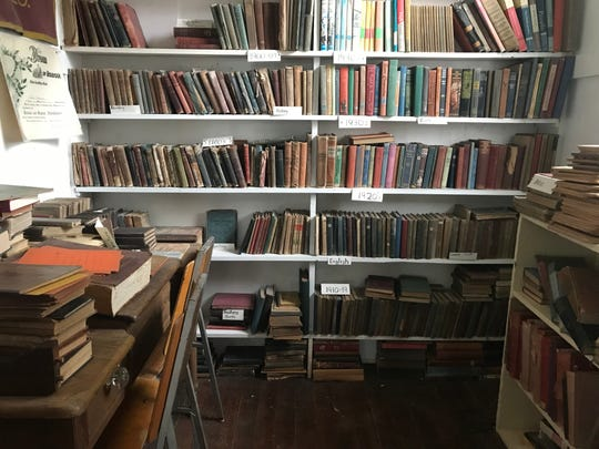 Donated books are sorted by year in the Mt. Hope School House. The school house is taken care of by Questers, a group of Warren County women dedicated to preserving the building.
