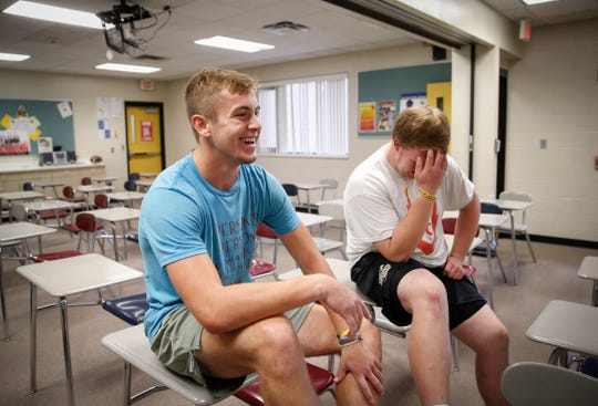Jaylen DeVries, left, and Ryan Thomas laugh as they share memories of the father of their friend, Nick Danielson, on Wednesday, Oct. 9, 2019 in Clear Lake. Danielson lost his father, who was an avid supporter of Clear Lake athletics and sports fan, to a lengthy battle with cancer back in February.