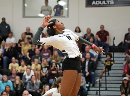 Ankeny Centennial senior and Wisconsin signee Devyn Robinson hits the return shot in a volleyball match on Tuesday, Oct. 8, 2019, at Ankeny Centennial High School.