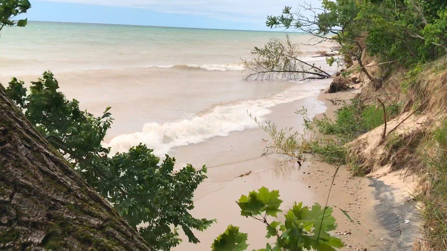 Home Falls Down Sandy Bluff Along Lake Michigan Shoreline