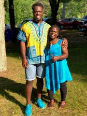 Michigan defensive end Kwity Paye and his mother Agnes Paye.