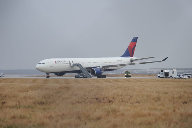 This picture provided by J.P. Karas shows Northwest Airlines Flight 253 on the runway after arriving at Detroit Metropolitan Airport from Amsterdam on Friday, Dec. 25, 2009.