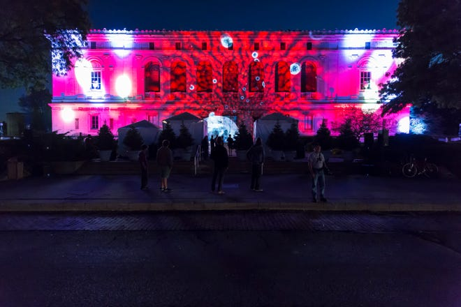 The main branch of the Detroit Public Library is decorated in lights during a Dlectricity festival in Midtown.