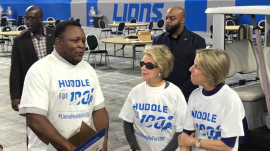 (From left) Barry Sanders, Lions owner Martha Firestone Ford and executive vice chair Sheila Ford Hamp talk during the food drive event at Ford Field on Thursday, Oct. 10, 2019.