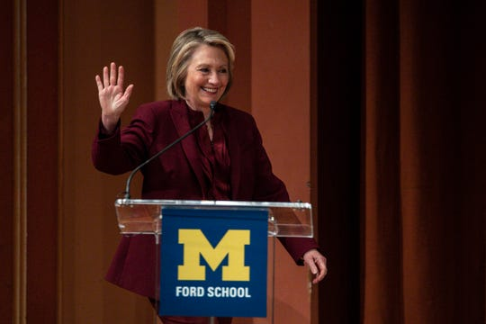 Former Secretary of State Hillary Clinton waves at the crowd as she walk onto stage during the Weiser Diplomacy Center Inaugural Lecture at the U-M's Rackham, Auditorium in Ann Arbor, Thursday, Oct. 10, 2019.