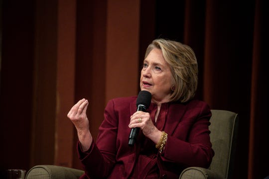 Former Secretary of State Hillary Clinton answers a question from host U-M Dean of Public Policy Michael Barr (not in the photo) during the Weiser Diplomacy Center Inaugural Lecture at the U-M's Rackham, Auditorium in Ann Arbor, Thursday, Oct. 10, 2019.
