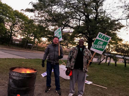 Gary Henrion, 47, and Victor Hayworth, 61, walked early in the morning garment line at the body shop gate at GM Detroit-Hamtramck's assembly plant on Thursday, October 10 - the 25th day of the national strike at the automaker.