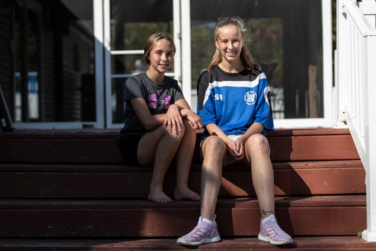 Olivia Bowen, 11, left, and her sister Brynn, 14, pose for a photo in their backyard in Marcellus, Wednesday, Oct. 9, 2019.